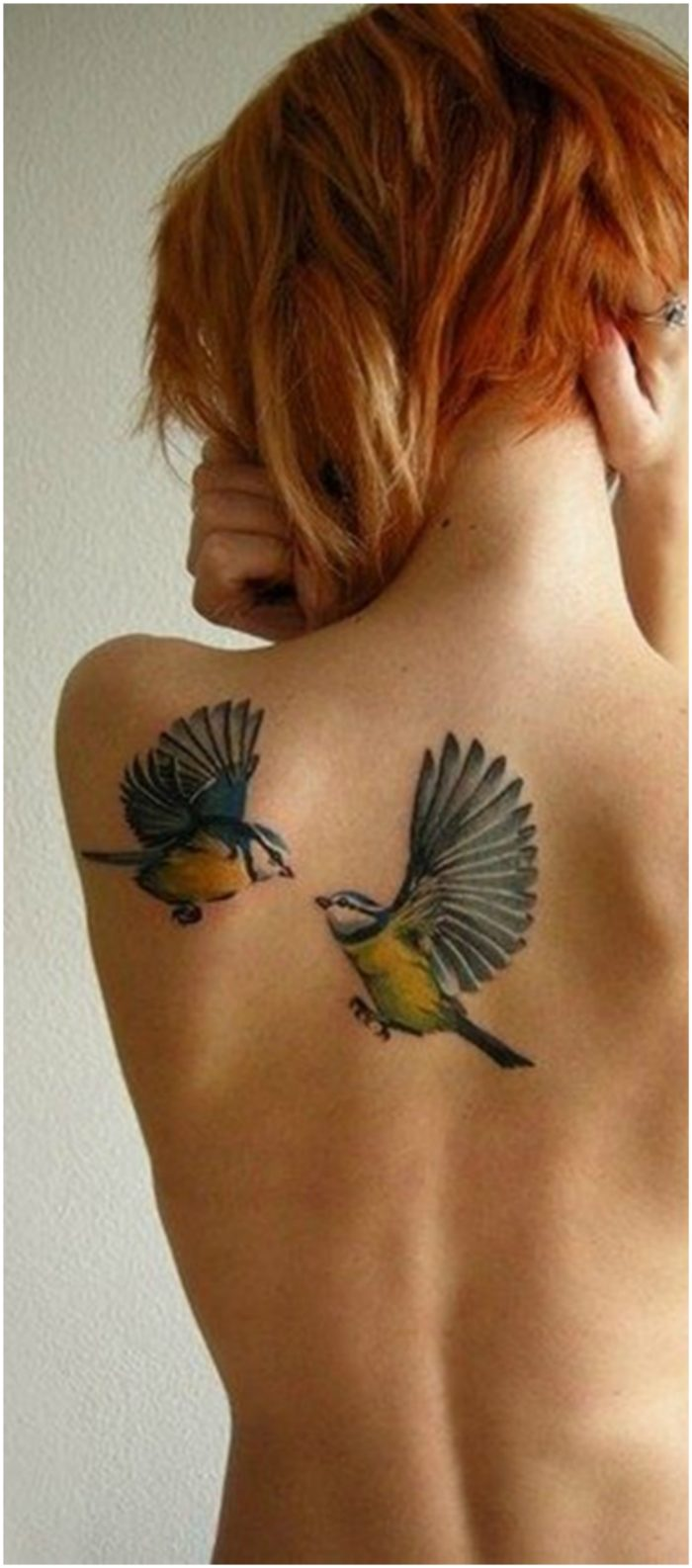 Bird back tattoo