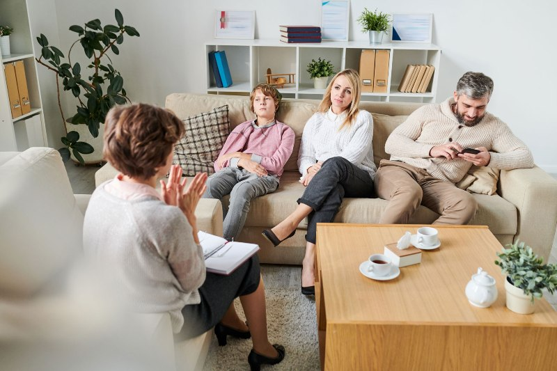 Psychologist explaining situation to family at session